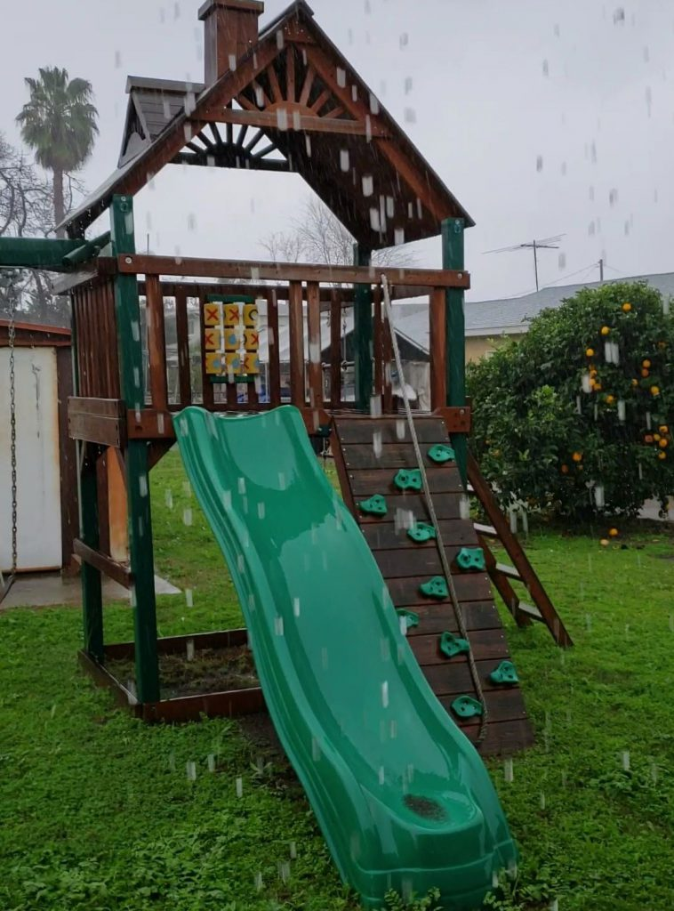 The play-set in the rain.