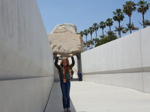 Caitlin lifts the rock.